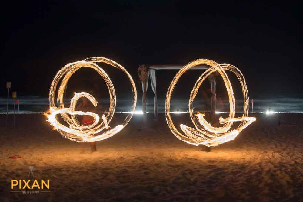 Summer wedding beach fire entertainment