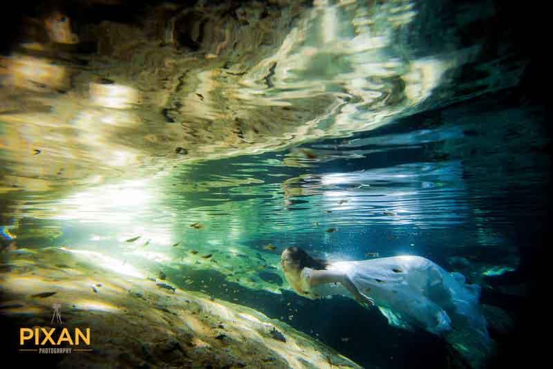 Bride in magical Riviera Maya Cenote Trash The Dress Photo