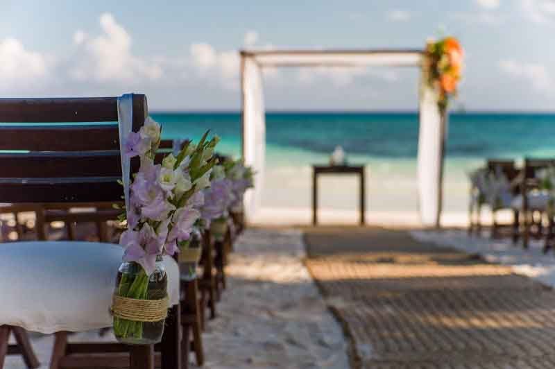 flower decoration on chairs at a destination wedding in Riviera Maya
