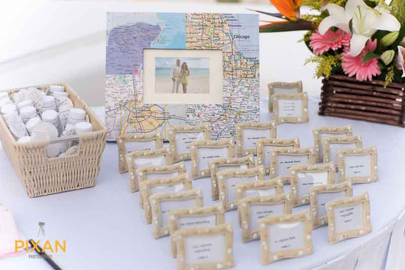 table places assignment displayed in min frames made from sea shells