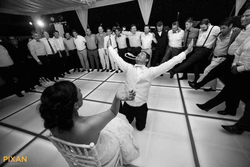 wedding photo journalism, the joy of the garter