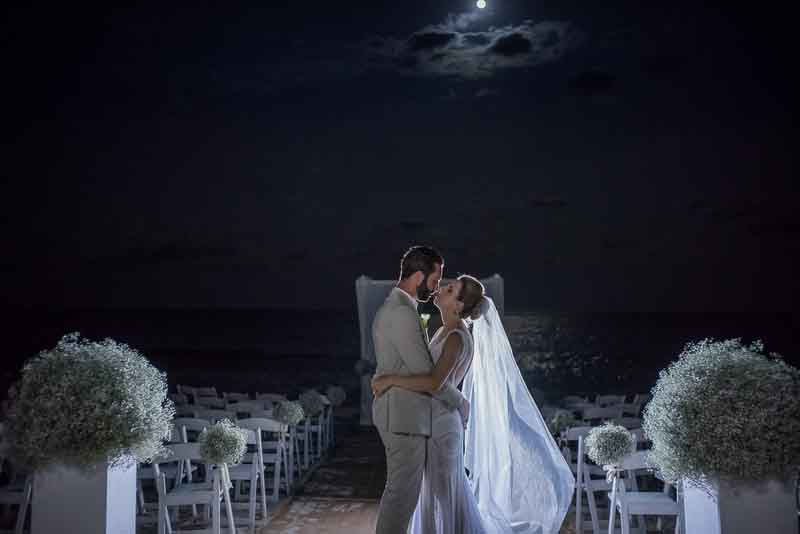 Moonlite wedding photo on the beach at Fairmont Mayakoba