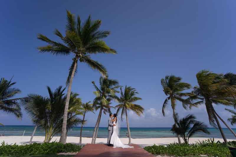 summer time wedding photography riviera maya palms and beach