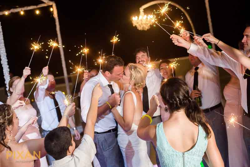 sparklers and guests add warm romance to this 1st dance