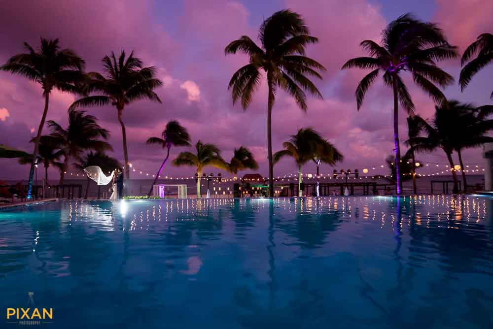 Romance Azul Fives Playa del Carmen at sunset with pool and palms