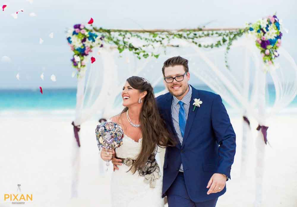 couple all smiles moment after marrying on the beach in Cancun