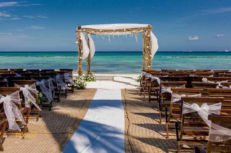 minimal beach ceremony design, incredible ocean color