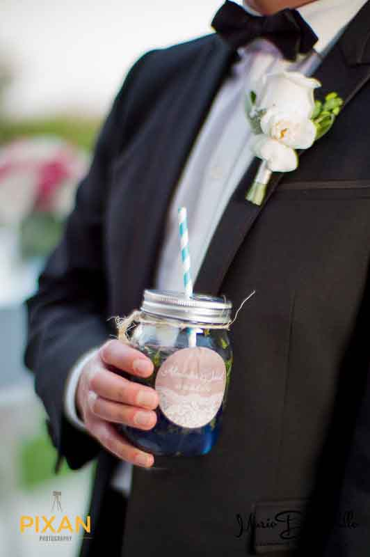 mason jar drink in grooms hand