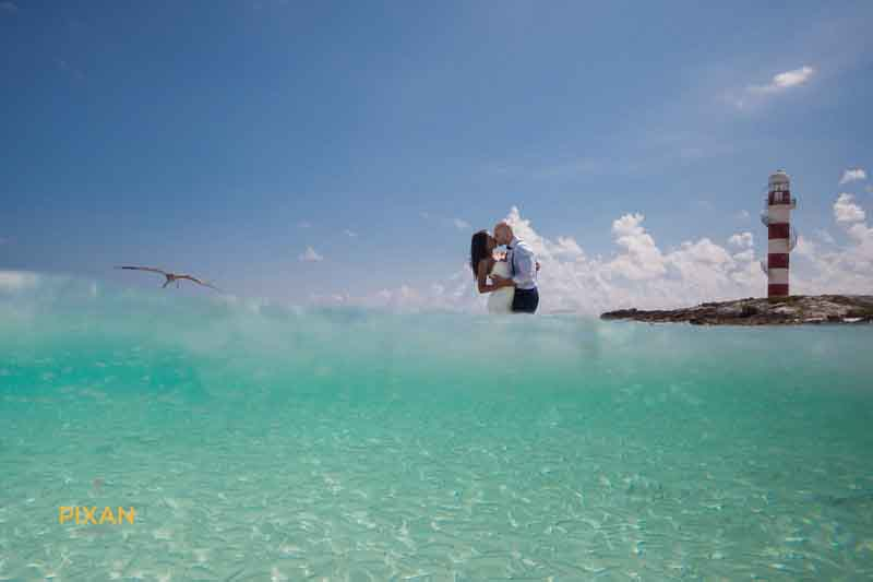 trash the dress cancun couple, fish, sea gull, lighthouse
