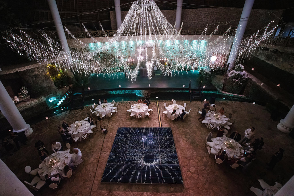 La Isla Xcaret Reception decor tables, chandelier and dancefloor