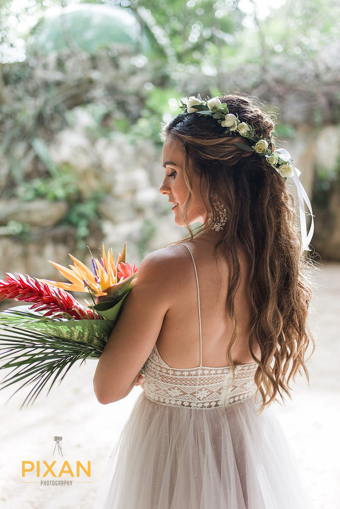 Hotel-Xcaret-Mexico-Wedding--bride-with-flowers