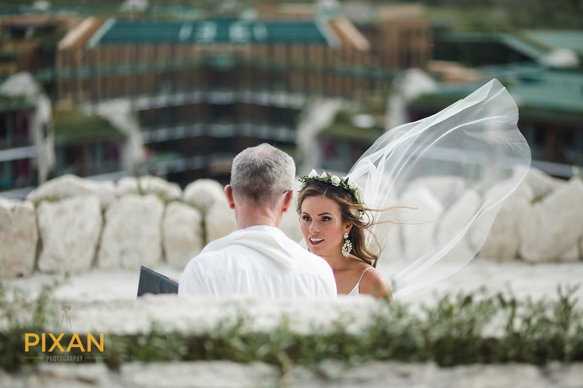 Hotel-Xcaret-Mexico-Wedding-bride-with-priest