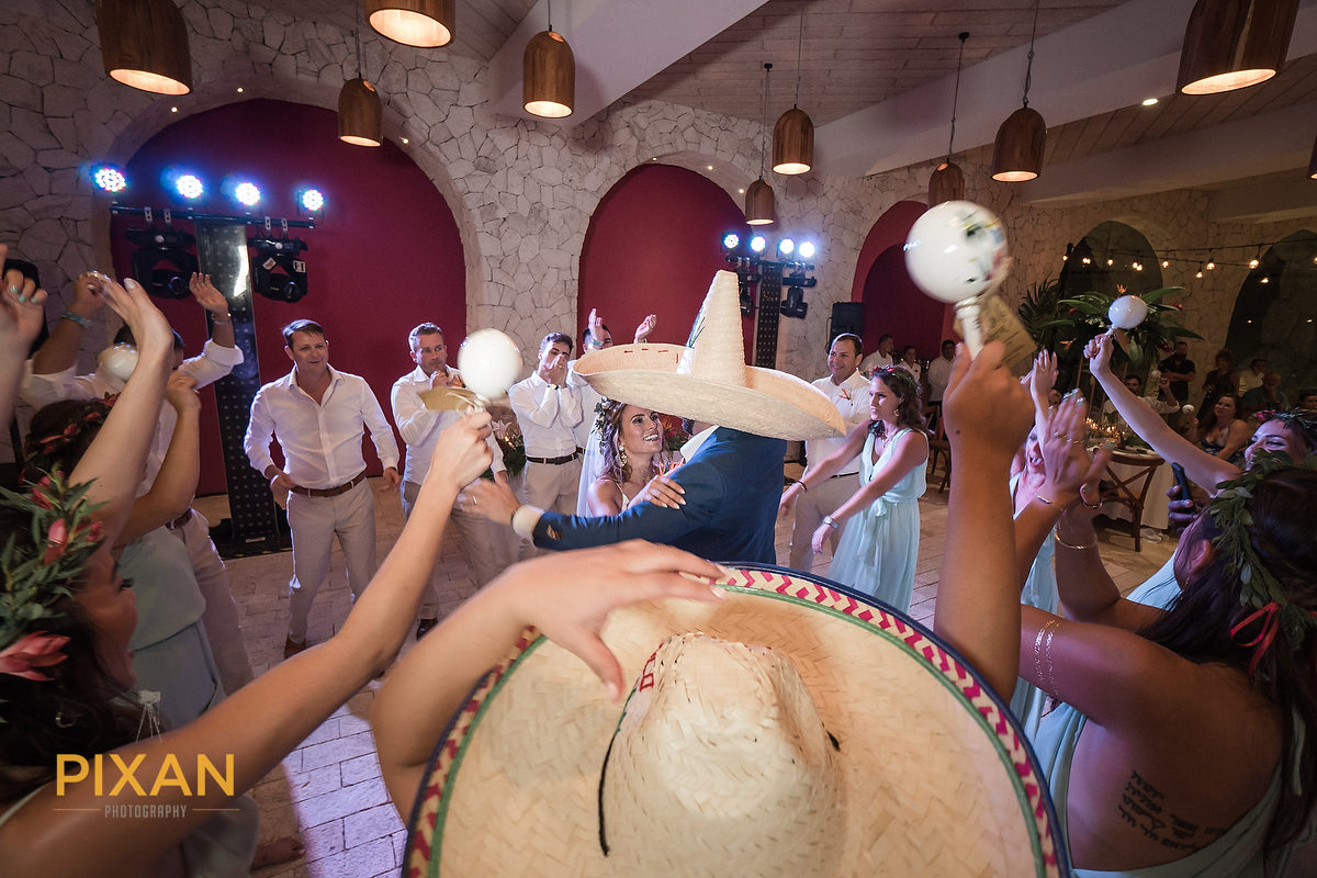 Hotel-Xcaret-Mexico-Wedding-reception-entry-dance-hats-maracas