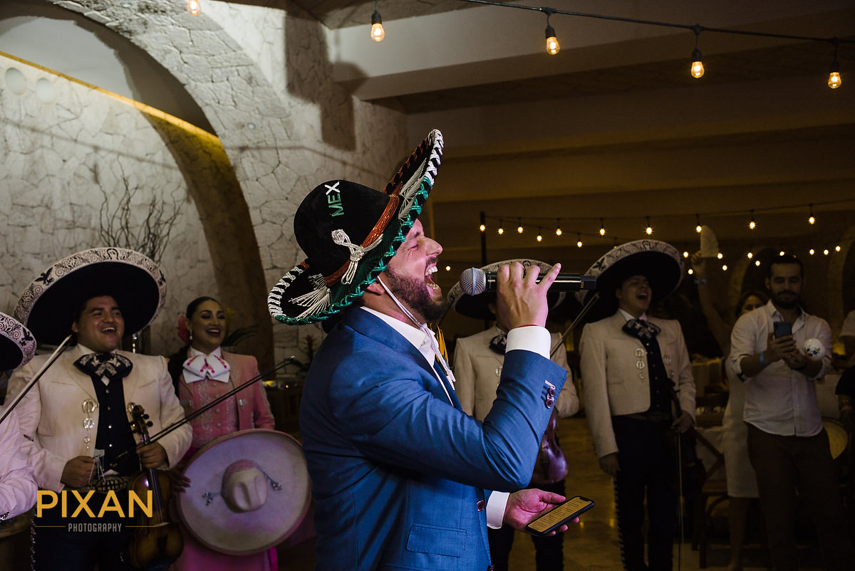 Hotel-Xcaret-Mexico-Wedding-groom-sings-mariachi