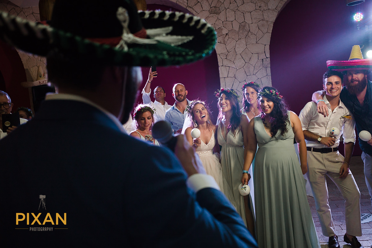 Hotel-Xcaret-Mexico-Wedding-groom-sings-mariachi-bride-friends-enjoy