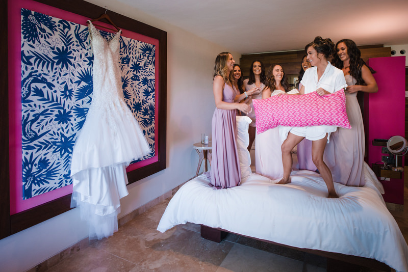 Hotel Xcaret Mexico Indian Mixed Destination Wedding getting ready bridesmaids pillow fight