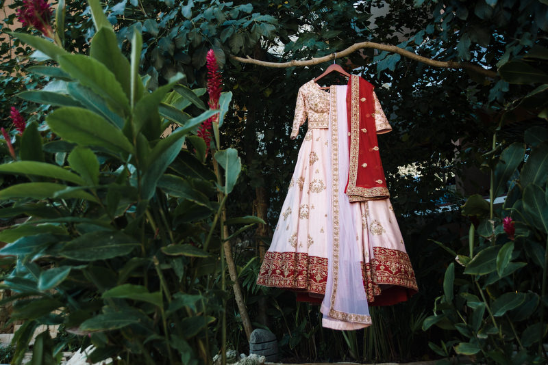 Hotel Xcaret Mexico Indian Mixed Destination Wedding brides dress