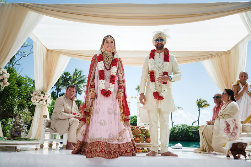 Hotel Xcaret Mexico Indian Mixed Destination Wedding Bride and groom Hindu Ceremony
