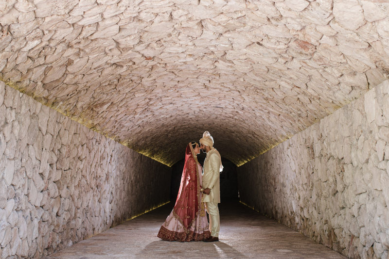 Hotel Xcaret Mexico Indian Mixed Destination Wedding tunnel bridal photo