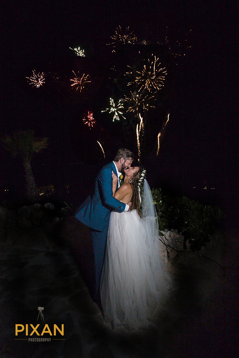 Hotel-Xcaret-Mexico-Wedding-fireworks-kiss