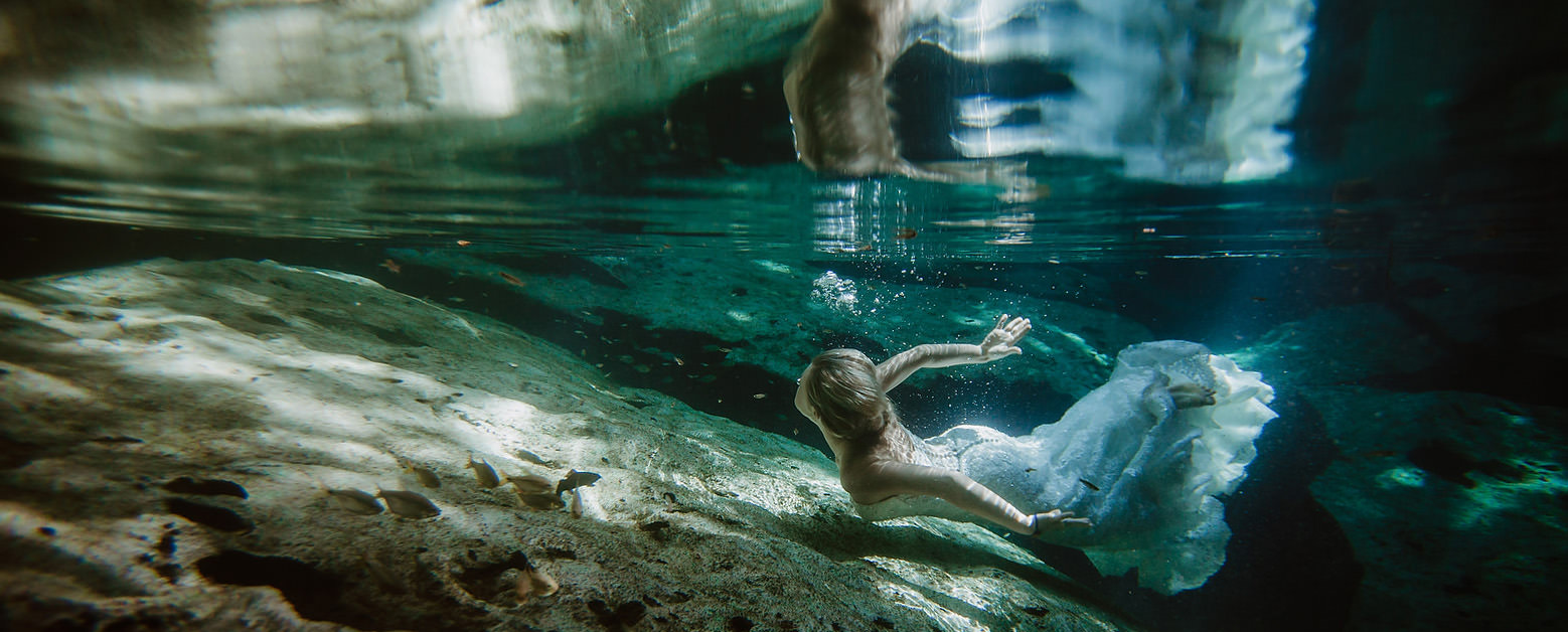 bride cenote swim underwater wedding photography