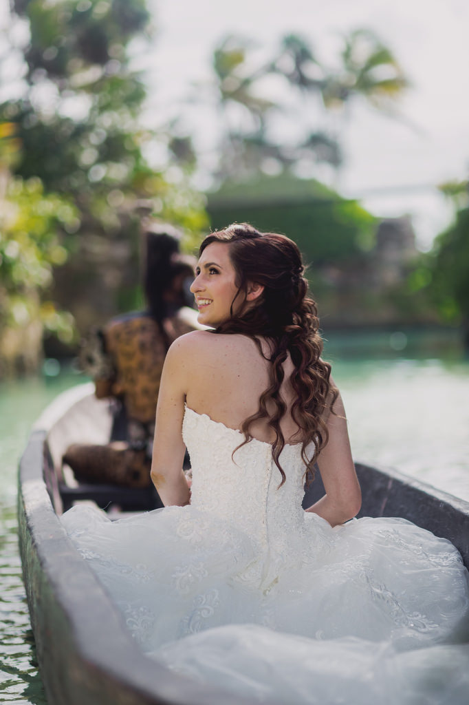 Bride in boat with Mayan Warrior