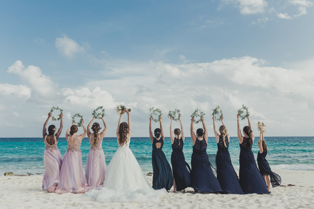 bridesmaids with flowers on the beach