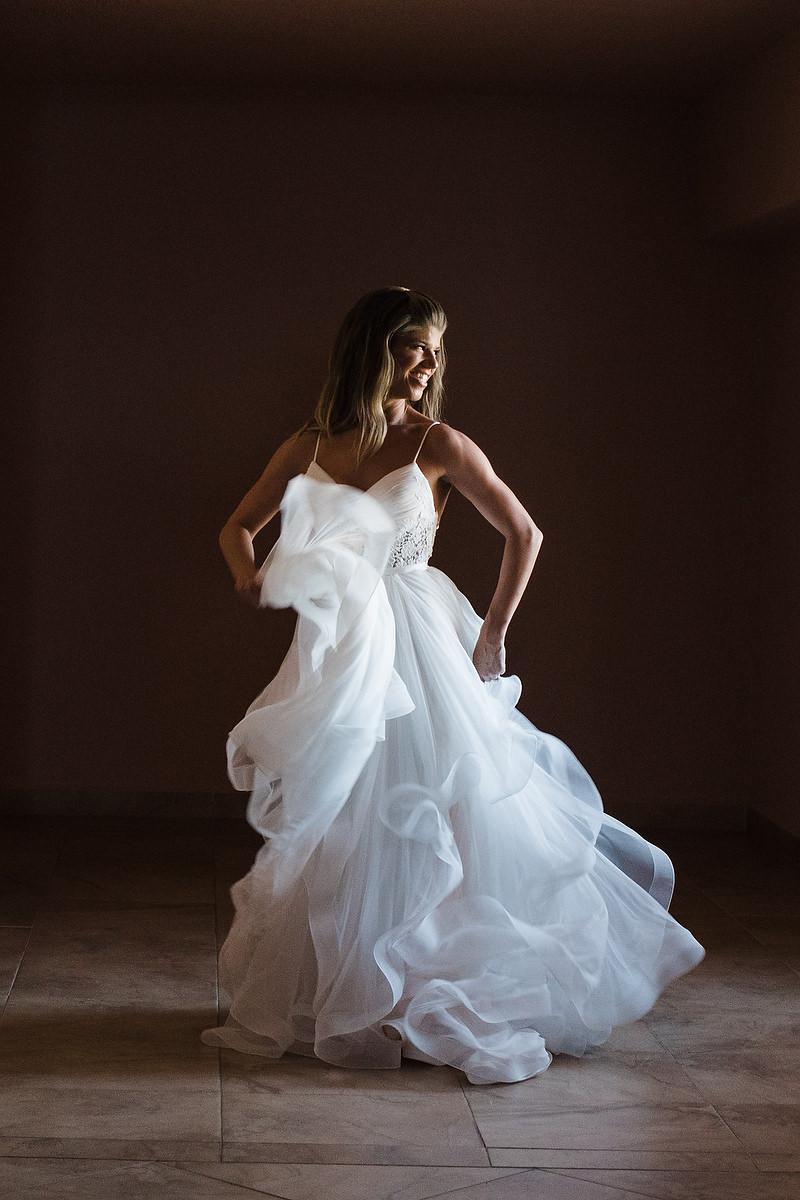 Bride dancing in her wedding dress