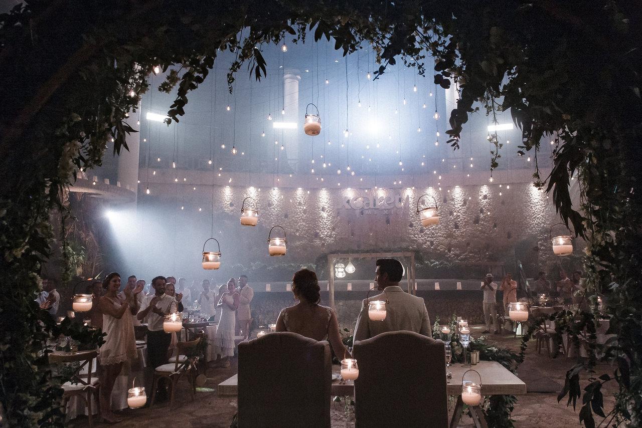 Xcaret Park La Isla Wedding Venue bride and groom's table guests applaud